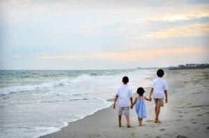 Children Holding Hands on Beach