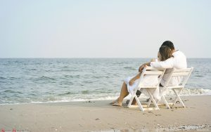 Couple in chair on Beach