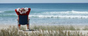 Santa Relaxing on Beach