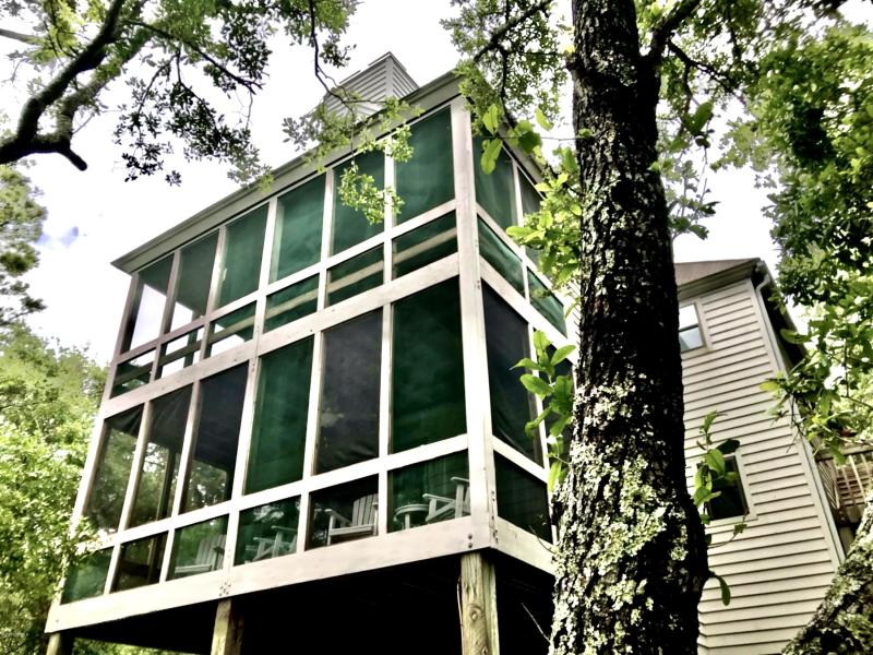 Price $449,000-  Enjoy a private, marsh-view condo on Bald Head Island. This move-in ready Timbercreek condominium has recently renovated bathrooms, an updated kitchen, new sliding doors and windows in the main living area, a private screened-in porch and bamboo floors throughout. It comes with a well maintained 6-seater cart AND a new Curtis Cab all-season cart. Furnished with exclusions. BHI Lifestyle and Shoals Club memberships available for separate purchase. Timbercreek amenities include a salt-water pool and private day docks on the marsh. The HOA covers all exterior and grounds maintenance so that you can enjoy a stress-free vacation home on BHI.